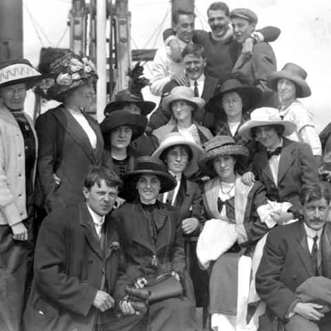 A group, in which the women are wearing heavily decorated hats.