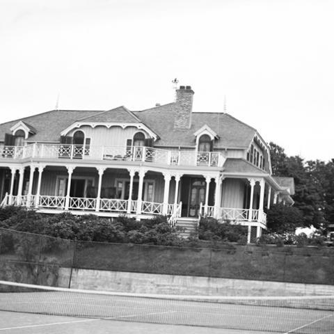 A villa with a tennis court.